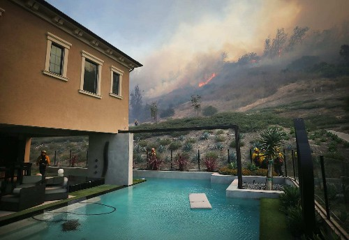 California wildfires force tens of thousands to evacuate Orange County amid strong winds