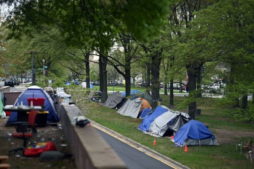 Two blocks from the Federal Reserve, a growing encampment of the homeless grips the economy's most powerful person