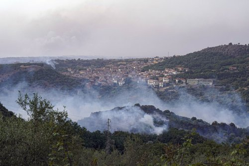 In aftermath of German floods, fires burn in southern Europe as rains drench London