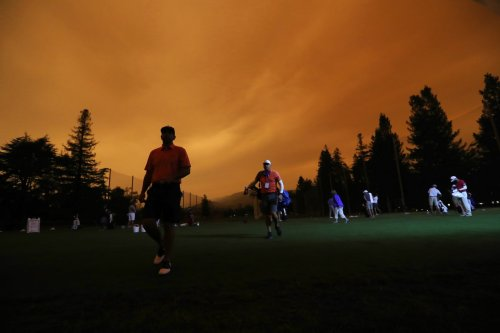 PGA Tour golfers play amid orange skies, smoky conditions because of California wildfires