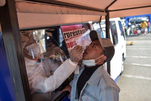 Indonesian airport workers accused of reusing nasal swabs for coronavirus testing