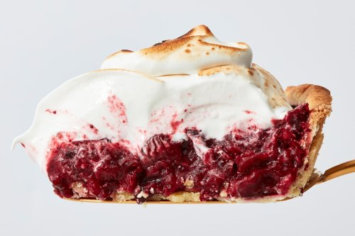 Tart roasted cranberries and a billowy meringue topping take this pie in a bright, bold direction