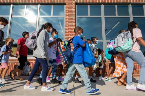 Reunions, tough goodbyes as Fairfax County schools welcome students back to classrooms