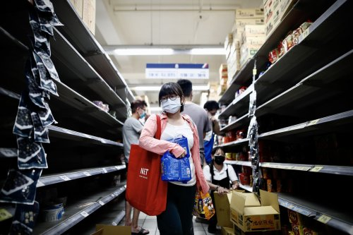 Taiwan raises coronavirus alert level as residents stockpile toilet paper and food