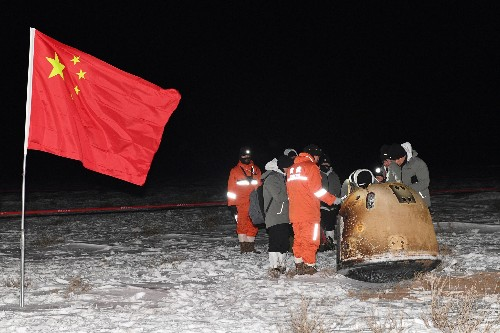 China moon mission returns to Earth, vaulting nation into ranks of space powers