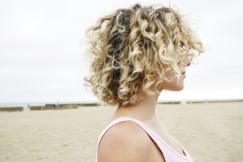If Summer Has Taken a Toll on Your Hair, This Is the One Product You Need To Bring It Back to Life