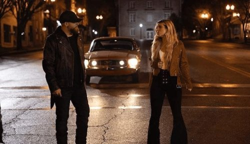 """Brantley Gilbert & Lindsay Ell Take You Back Home With New """"What Happens In A Small Town"""" Video"""