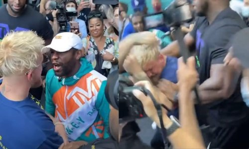 Jake Paul Incites Brawl With Floyd Mayweather At Press Conference, Leaves With Busted Tooth & Black Eye