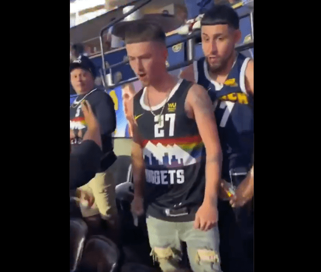 Suns Fan Delivers All-Time Great Beatdown To Nuggets Fan With All-Time Bad Haircut