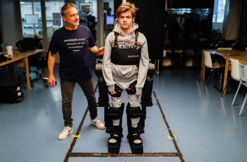 Father builds exoskeleton suit to help his son and others walk for the first time