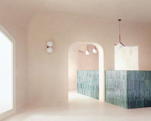 studio wok combines granite formations with Sardinian earth tones for Myrto Restaurant in Italy