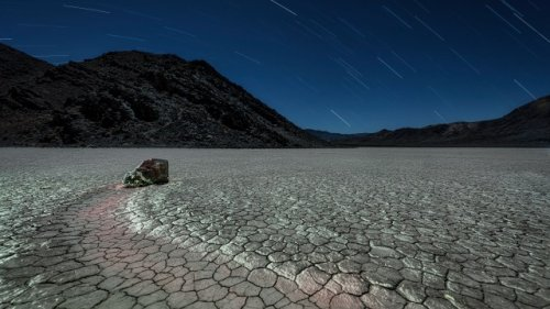Night adventure among the mysterious sliding stones in remote Death Valley National Park