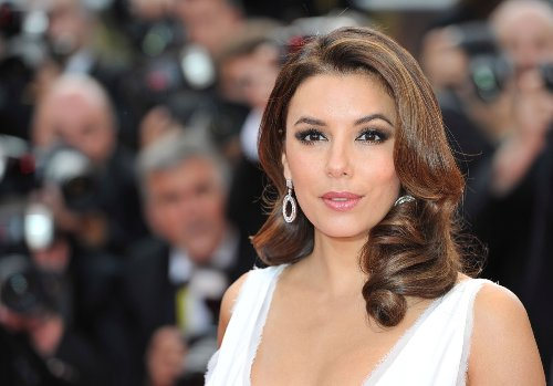 Eva Longoria in White Swimsuit Looks Fit After Trampoline Workout   Eat This Not That