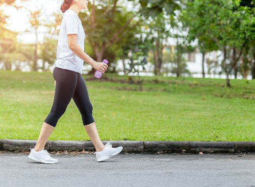 This Simple Walking Workout Is an Amazing Fat Burner, Says Top Trainer