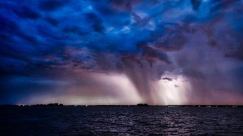 Capturing rain + lightning - cover