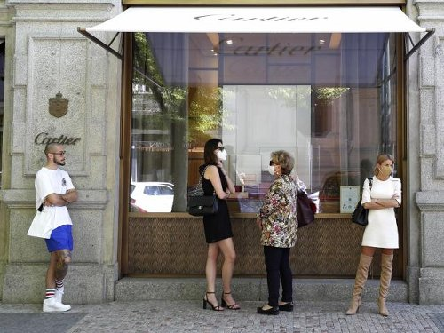 Czechs rejoice as stores reopen; honor COVID-19 victims