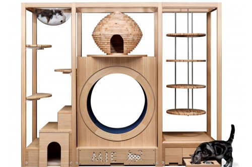 This multi-level cat tower balances the joy of a McDonald's PlayPlace with interior-friendly aesthetics!