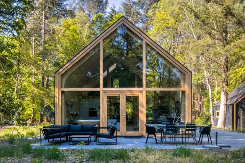 This prefab modular home includes an open floor plan + arched ceiling with curved pinewood walls!