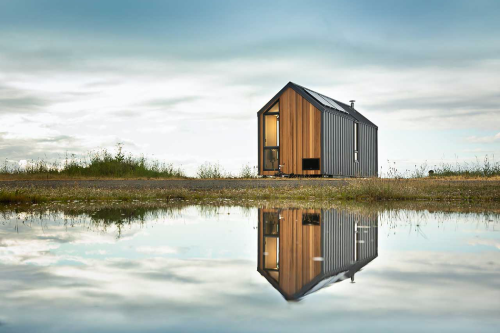 This tiny, prefabricated home travels with you from the coastlines to the mountain tops!