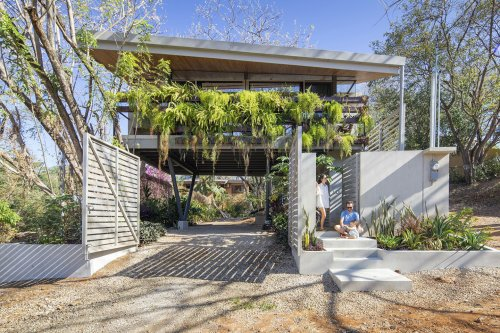 This sustainable modern house provides food, water, power & protection for 100% off-grid living!