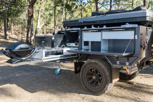 This off-grid trailer expands to include an outdoor shower and a MasterChef worthy kitchen