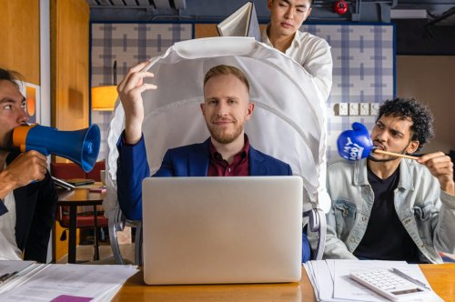 Back at the office with noisy coworkers? This privacy hood keeps sounds and nosy people away