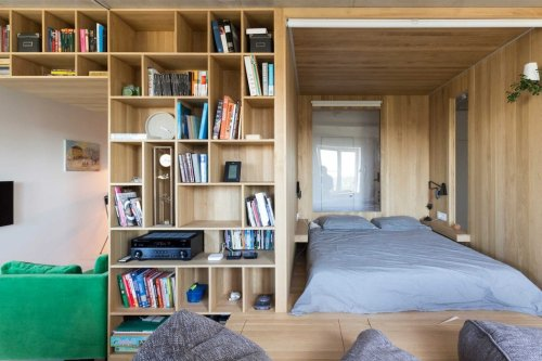 A Multifunctional wooden 'bedroom box' creates a whole new room and storage area for this tiny apartment!