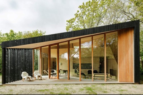 This prefab holiday home in Netherlands has transforming rooms that go from day to night instantly!