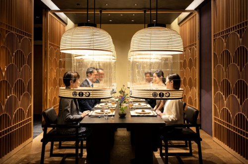 Tokyo's hotel designs new pandemic-era dining experience with transparent lanterns for guests to enjoy a face mask-free dinner!