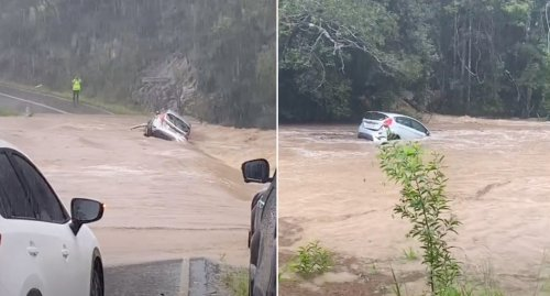'Oh my god': Scary moment car is washed away in floodwaters
