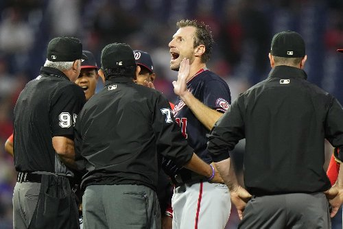 Nats GM Rizzo calls Phillies manager Girardi a 'con artist'