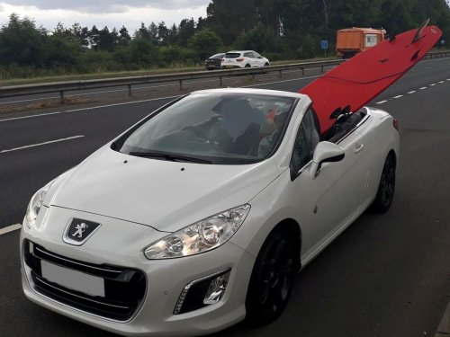 Driver stopped by North Yorkshire police due to surfboard sticking out of convertible on A64