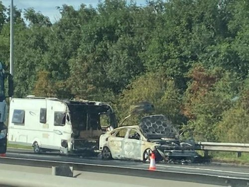 Shocking photos show damage to car and carvan after fire which closed M62