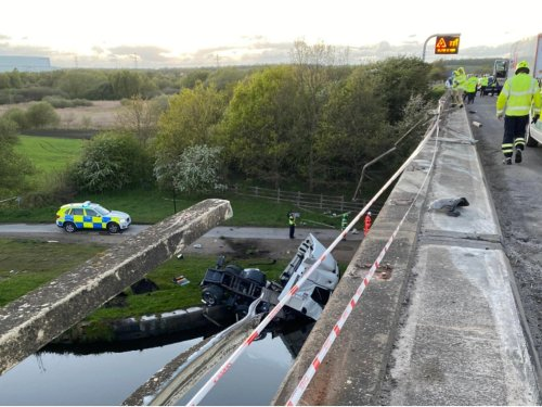 Shocking pictures show aftermath of huge M62 crash as HGV plummets from bridge - injury update