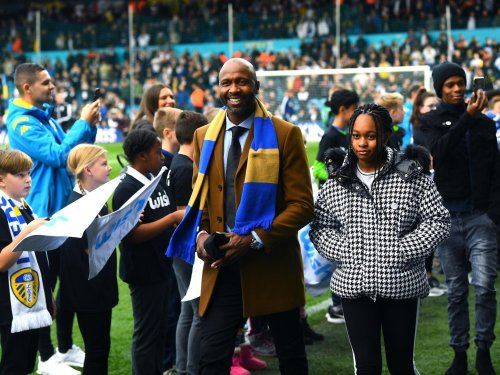 Watch as delighted Lucas Radebe opens Leeds gift and starts brilliant rendition of Marching on Together