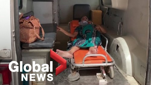 Indian hospital slammed by COVID-19 crisis as some patients treated in ambulances