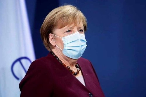 Merkel under fire over German COVID-19 lockdown law